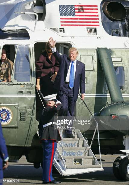 US President Donald Trump waves as he and his wife Melania arrive at Yokota Air Base on the outskirts of Tokyo on Nov 7 for their departure to South...