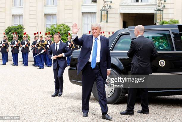 President Donald Trump waves as he arrives at the Elysee Presidential for a meeting with French President Emmanuel Macron on July 13 2017 in Paris...