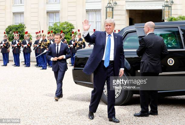 President Donald Trump waves as he arrives for a a meeting with French President Emmanuel Macron at the Elysee Presidential Palace on July 13 2017 in...