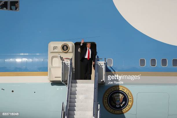 S President Donald Trump waves as he arrives on Air Force One at the Palm Beach International Airport for a visit to his MaraLago Resort for the...