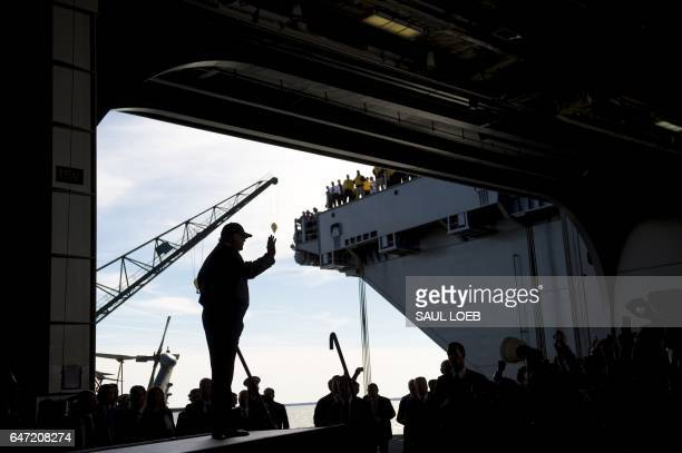US President Donald Trump waves as he arrives to speak aboard the precommissioned USS Gerald R Ford aircraft carrier in Newport News Virginia March 2...