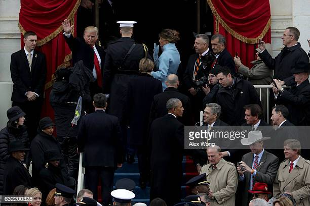 President Donald Trump waves as he leaves the US Capitol on January 20 2017 in Washington DC In today's inauguration ceremony Donald J Trump becomes...