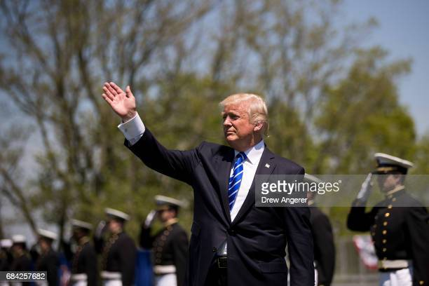 President Donald Trump waves as he prepares to exit the commencement ceremony for the US Coast Guard Academy May 17 2017 in New London Connecticut...
