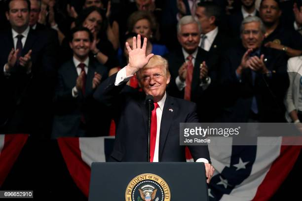 S President Donald Trump waves as he speaks about policy changes he is making toward Cuba at the Manuel Artime Theater in the Little Havana...