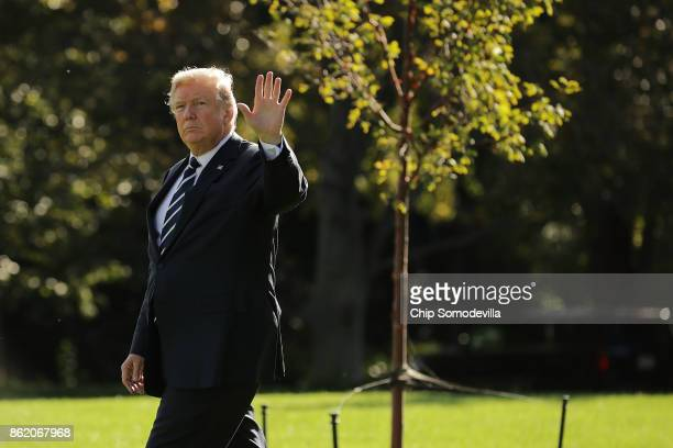 S President Donald Trump waves as he walks across the South Lawn before departing the White House on Marine One October 16 2017 in Washington DC...