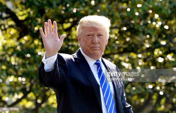 President Donald Trump waves as he walks towards Marine One while departing the White House on May 17 2017 in Washington DC en route to Connecticut /...