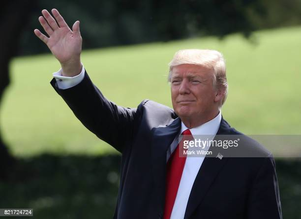 S President Donald Trump waves as walks to Marine One while departing from the White House on July 24 2017 in Washington DC President Trump is...