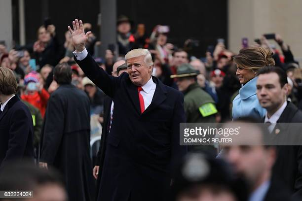 US President Donald Trump waves during the inaugural parade in Washington DC on January 20 2017 US President Donald Trump on Friday stepped out of...