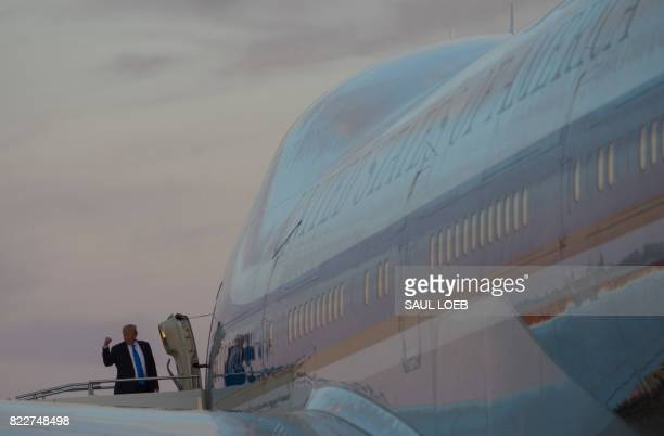 President Donald Trump waves from Air Force One prior to departure from YoungstownWarren Regional Airport in Vienna Ohio July 25 following a campaign...