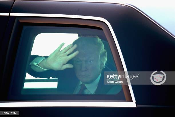 S President Donald Trump waves to guests as he leaves General Mitchell International Airport on June 13 2017 in Milwaukee Wisconsin Trump made brief...