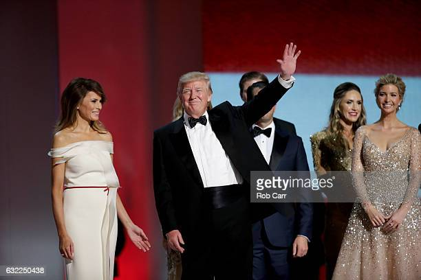 President Donald Trump waves to guests at the Liberty Inaugural Ball on January 20 2017 in Washington DC The Liberty Ball is the first of three...