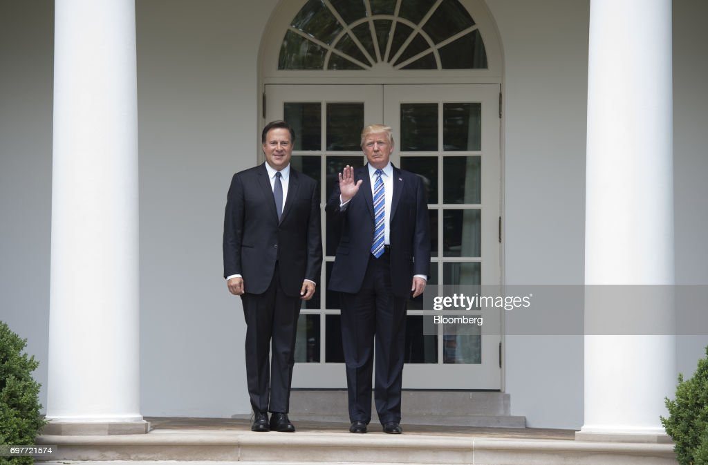 U.S. President Donald Trump waves to members of the media will standing for photographs with Juan Carlos Varela, Panama's president, left, near the Oval Office of the White House in Washington, D.C., U.S., on Monday, June 19, 2017. The U.S. is Panama's number one source of imports, accounting for 17 percent or $4.68 billion of the country's total imports, according to Massachusetts Institute of Technology's Observatory of Economic Complexity. Photographer: Molly Riley/Pool via Bloomberg