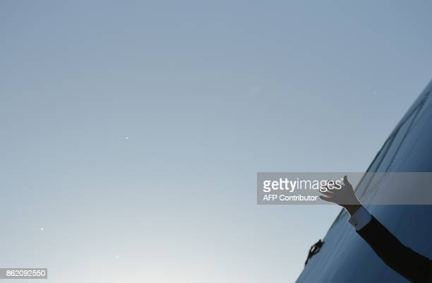 US President Donald Trump waves upon arrival at GreenvilleSpartanburg International Airport in Greer South Carolina on October 16 2017 Trump is in...