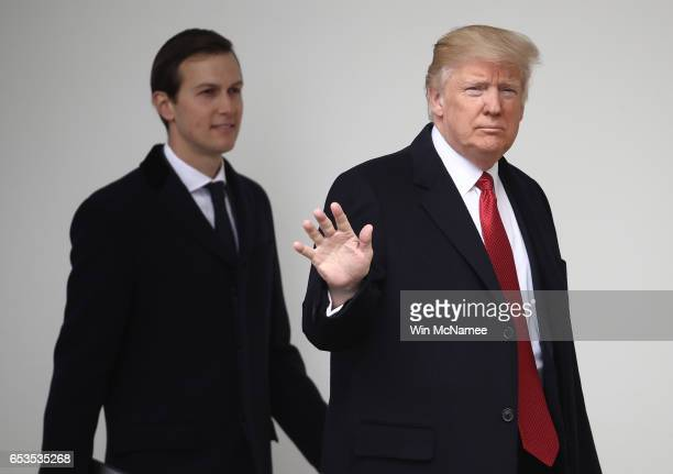 S President Donald Trump waves while walking to a waiting Marine One helicopter with soninlaw and senior advisor Jared Kushner while departing the...