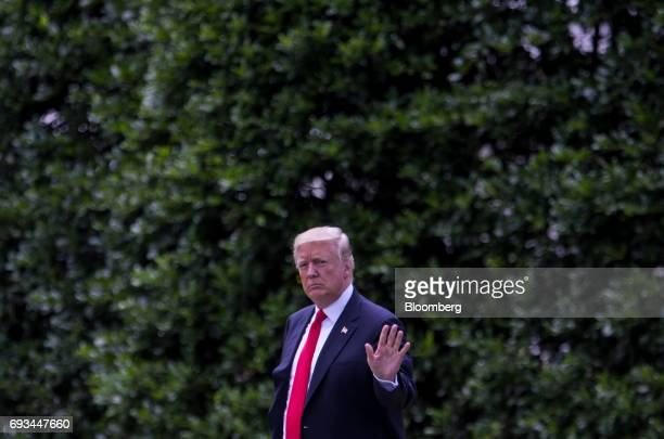 US President Donald Trump waves while walking towards Marine One to depart for Cincinnati on the South Lawn of the White House in Washington DC US on...
