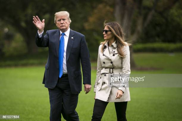US President Donald Trump waves while walking towards the White House on the South Lawn after disembarking Marine One with First Lady Melania Trump...