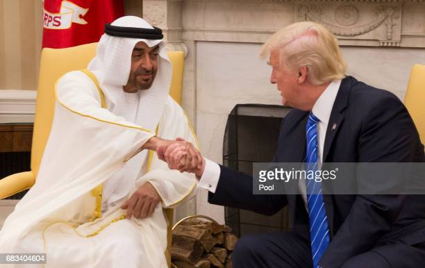 US President Donald Trump welcomes Crown Prince Shaikh Mohammad bin Zayed Al Nahyan of Abu Dhabi in the Oval Office of the White House on May 15 2017...