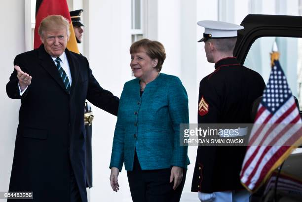 US President Donald Trump welcomes German Chancellor Angela Merkel to the White House on March 17 2017 in WashingtonDC US President Donald Trump on...