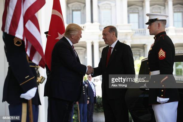 S President Donald Trump welcomes President Recep Tayyip Erdogan of Turkey outside the West Wing of the White House May 16 2017 in Washington DC...
