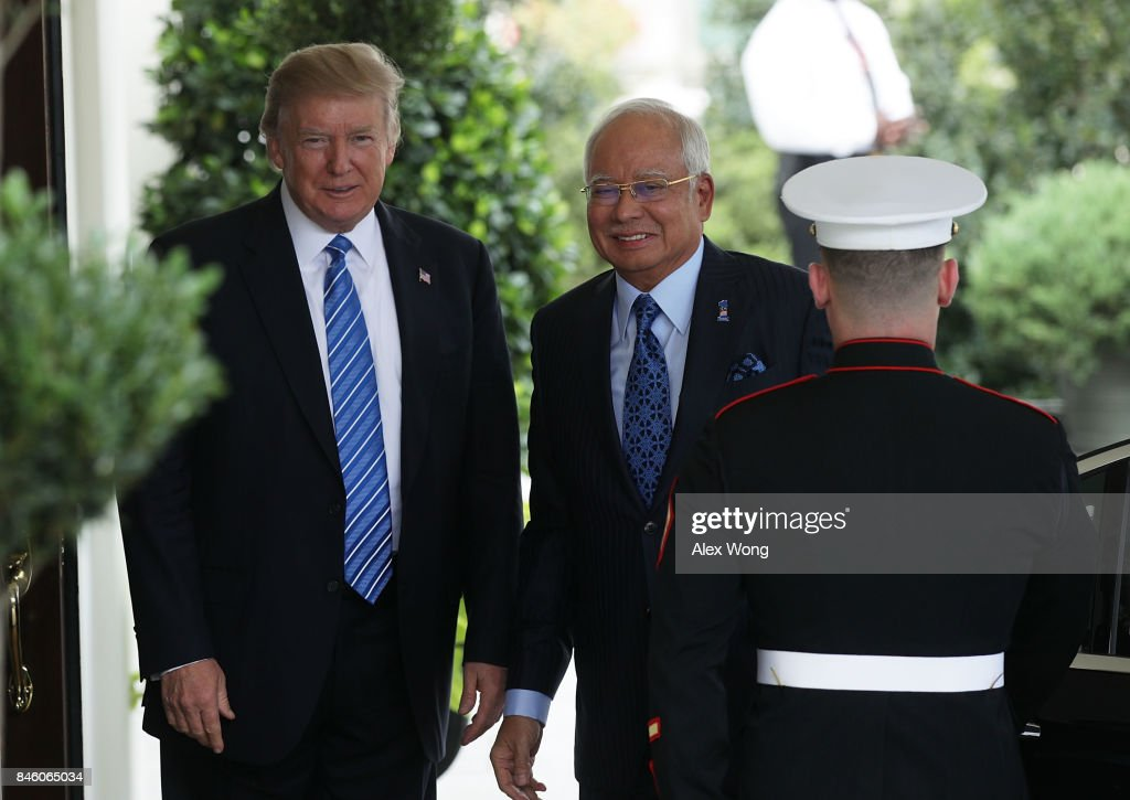 U.S. President Donald Trump (L) welcomes Prime Minister Najib Abdul Razak (2nd L) of Malaysia outside the West Wing of the White House September 12, 2017 in Washington, DC. Prime Minister Razak is on a three-day visit in Washington.