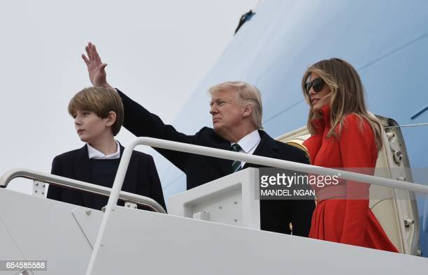 US President Donald Trump wife Melania and son Barron board Air Force One before departing from Andrews Air Force Base in Maryland on March 17 2017...