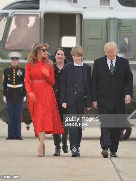 US President Donald Trump wife Melania and son Barron make their way to board Air Force One before departing from Andrews Air Force Base in Maryland...