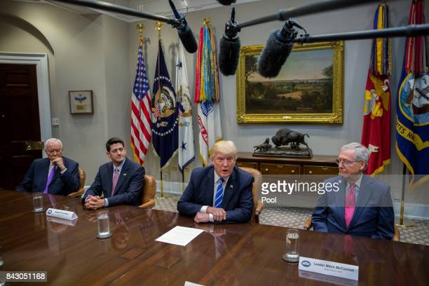 President Donald Trump with Chairman of the Senate Finance Committee Orrin Hatch Speaker of the House Paul Ryan and Senate Majority Leader Mitch...