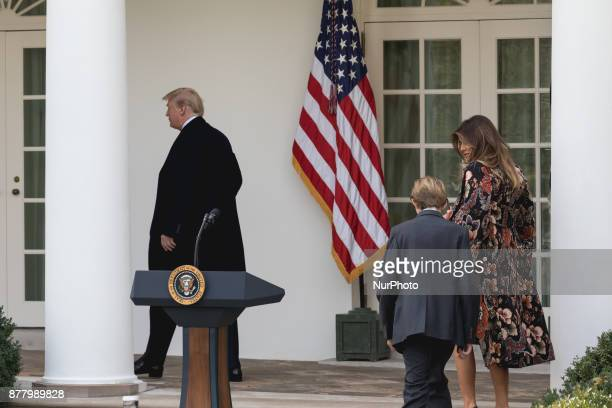 President Donald Trump with First lady Melania Trump and son Barron Trump following behind him leave the Rose Garden after the pardoning of Drumstick...
