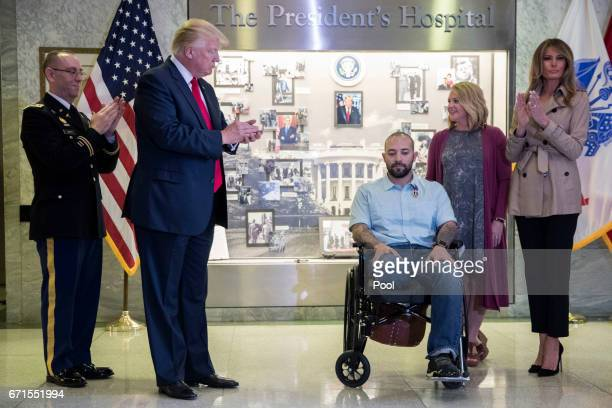 US President Donald Trump with First Lady Melania Trump applaud Sergeant First Class Alvaro Barrientos with his wife Tammy Barrientos after awarding...