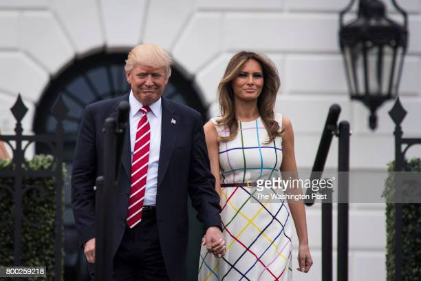 President Donald Trump with first lady Melania Trump arrive during the Congressional Picnic on the South Lawn of the White House in Washington DC on...