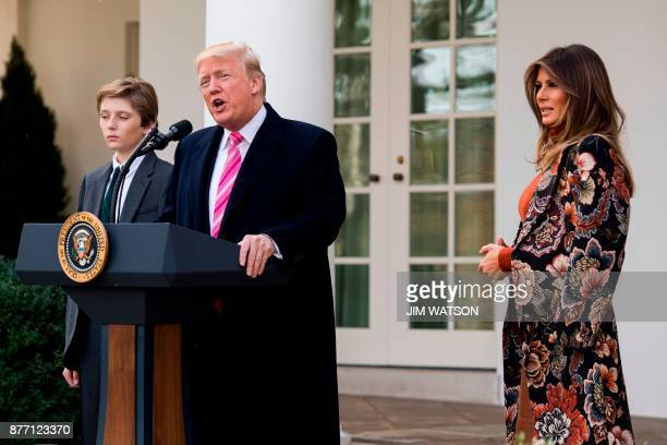 US President Donald Trump with his son Barron speaks alongside First Lady Melania Trump before pardoning the Thanksgiving turkey Drumstick in the...