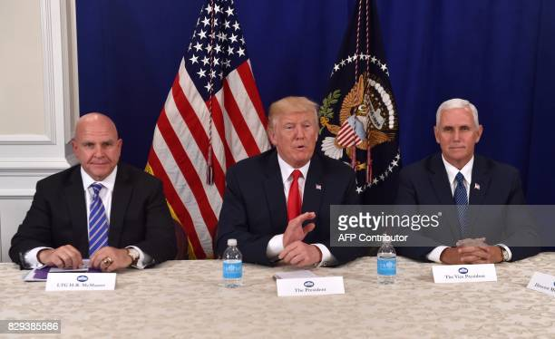US President Donald Trump with National Security Advisor H R McMaster and Vice President Mike Pence speaks during a security briefing on August 10 at...