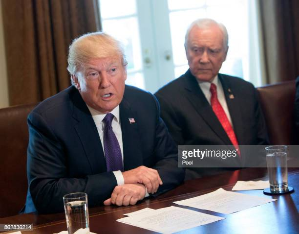 US President Donald Trump with Sen Orrin Hatch Chairman of the Senate Finance Committee speaks during a meeting with members of the Senate Finance...