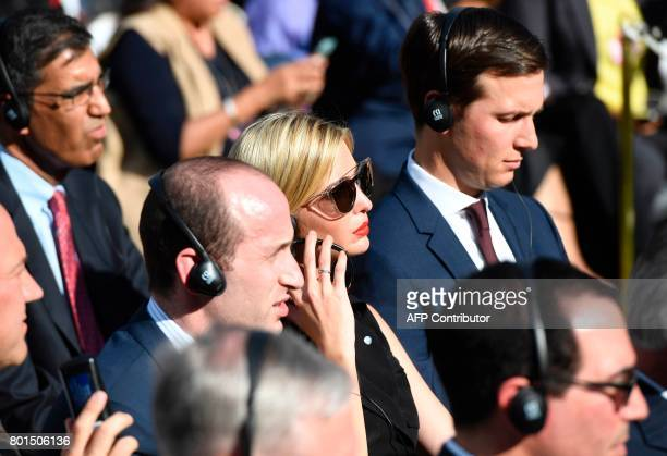 US President Donald Trump's daughter Ivanka Trump and her husband and senior adviser to US President Jared Kushner listen to US President and Indian...