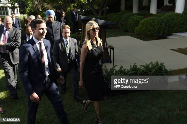 US President Donald Trump's daughter Ivanka Trump and her husband and senior adviser to US President Jared Kushner walk in the Rose Garden of the...