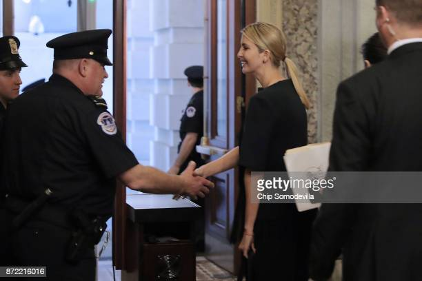 President Donald Trump's daughter Ivanka Trump shakes hands with Capitol Police officers as she leaves the US Capitol November 9 2017 in Washington...