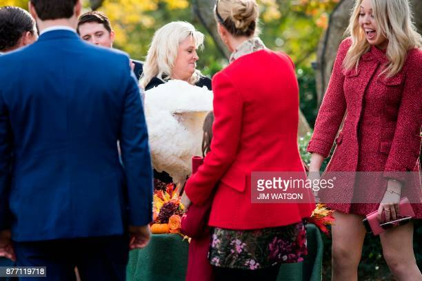 US President Donald Trump's daughter Tiffany reacts as pardoned Thanksgiving turkey Drumstick ruffles his feathers in the Rose Garden of the White...