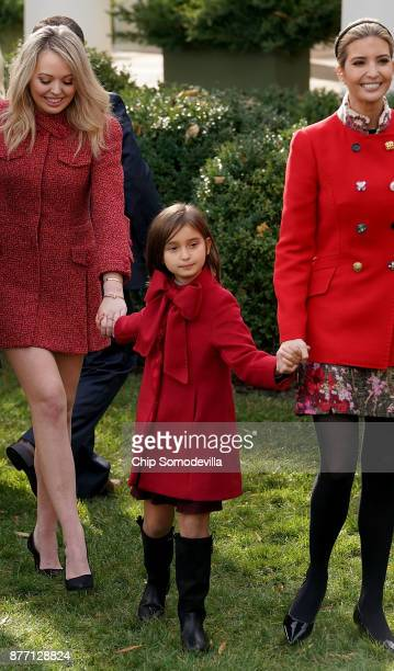 S President Donald Trump's daughters Tiffany Trump and Ivanka Trump and her daughter Arabella Kushner leave the Rose Garden after the pardoning...