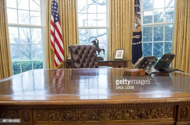 US President Donald Trump's desk the Resolute Desk is seen in the Oval Office of the White House in Washington DC March 31 2017 / AFP PHOTO / SAUL...