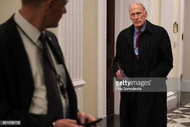 President Donald Trump's nominee for director of national intelligence former Sen Dan Coats walks through the halls of the Eisenhower Executive...