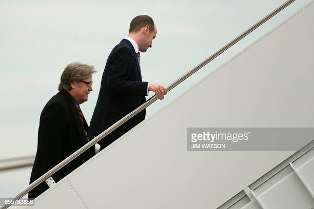 US President Donald Trump's White House Senior Advisors Stephen Miller and Steve Bannon board Air Force One at Andrews Air Force Base Maryland March...