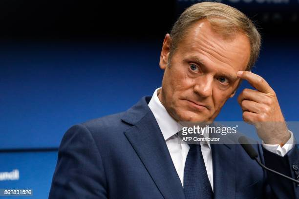 EU President Donald Tusk gestures during a press conference following a tripartite social summit at the European Council in Brussels on October 18...