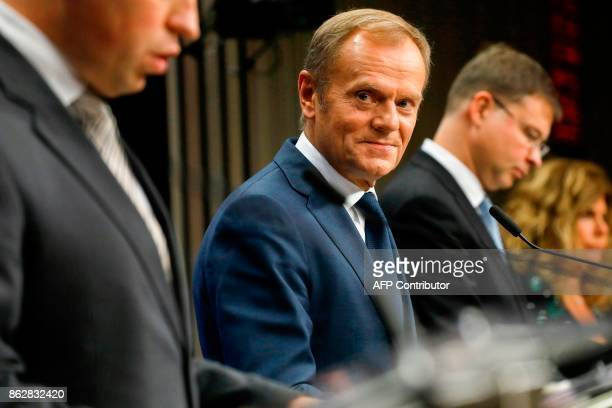 EU President Donald Tusk looks on during a press conference following a tripartite social summit at the European Council in Brussels on October 18...
