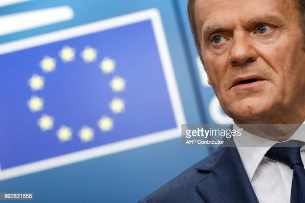 EU President Donald Tusk speaks during a press conference following a tripartite social summit at the European Council in Brussels on October 18 2017...