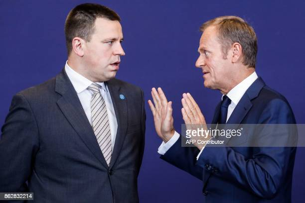 EU President Donald Tusk talks with Estonia prime minister Juri Ratas during a group photo following a tripartite social summit at the European...
