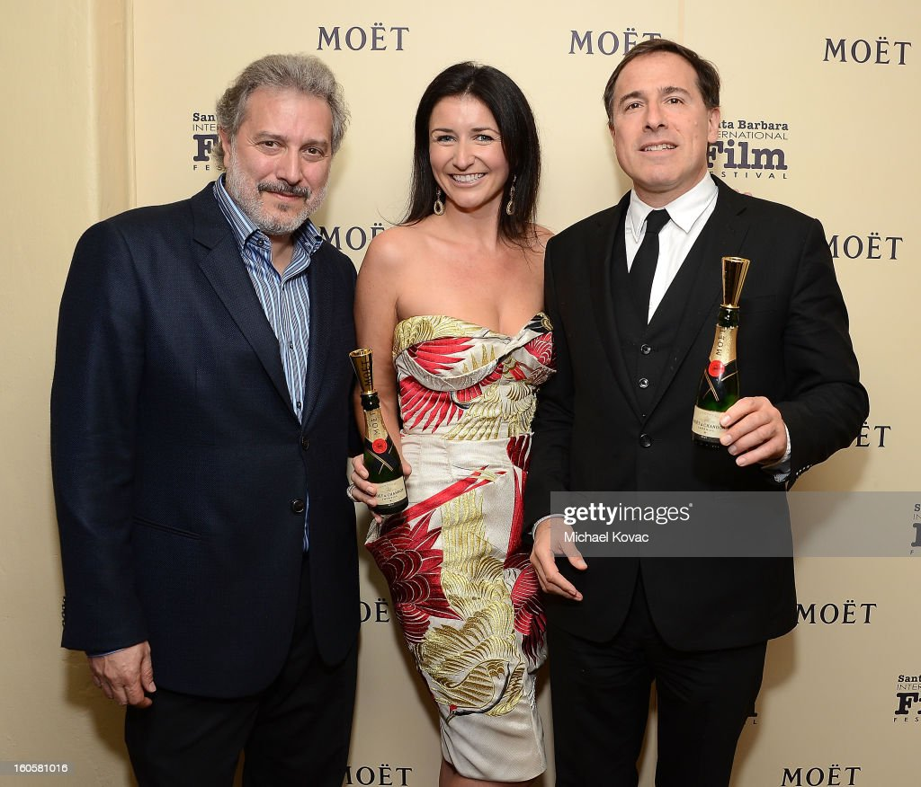 SBIFF president Douglas Stone, Moet's Julia Fitzroy, and director <a gi-track='captionPersonalityLinkClicked' href=/galleries/search?phrase=David+O.+Russell&family=editorial&specificpeople=215306 ng-click='$event.stopPropagation()'>David O. Russell</a> visit The Moet & Chandon Lounge at The Santa Barbara International Film Festival on February 2, 2013 in Santa Barbara, California.