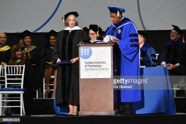 President Dr Joyce F Brown presents an honorary degree to Founder of Essie Cosmetics Ltd Essie Weingarten onstage during The Fashion Institute of...