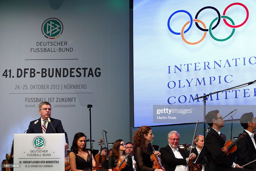 IOC president Dr. <a gi-track='captionPersonalityLinkClicked' href=/galleries/search?phrase=Thomas+Bach&family=editorial&specificpeople=610149 ng-click='$event.stopPropagation()'>Thomas Bach</a> talks to the audience during the DFB Bundestag at the NCC Nuremberg on October 24, 2013 in Nuremberg, Germany.