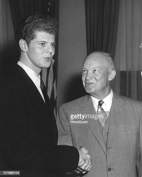 US President Dwight Eisenhower shakes hands with pianist Van Cliburn at the White House Washington DC May 23 1958