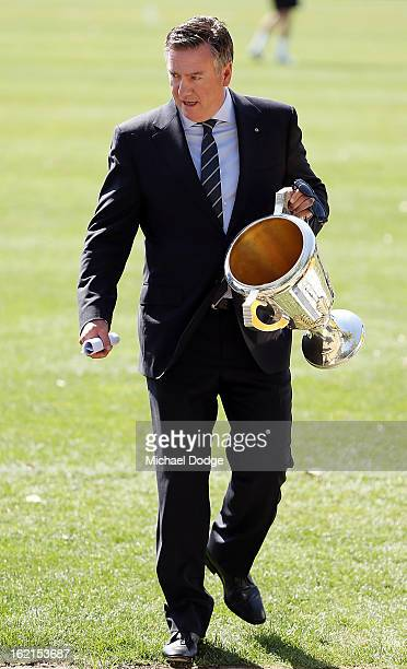 President Eddie McGuire holds the 2010 Premiership Cup during a Collingwood Magpies AFL training session at Gosch's Paddock on February 20 2013 in...